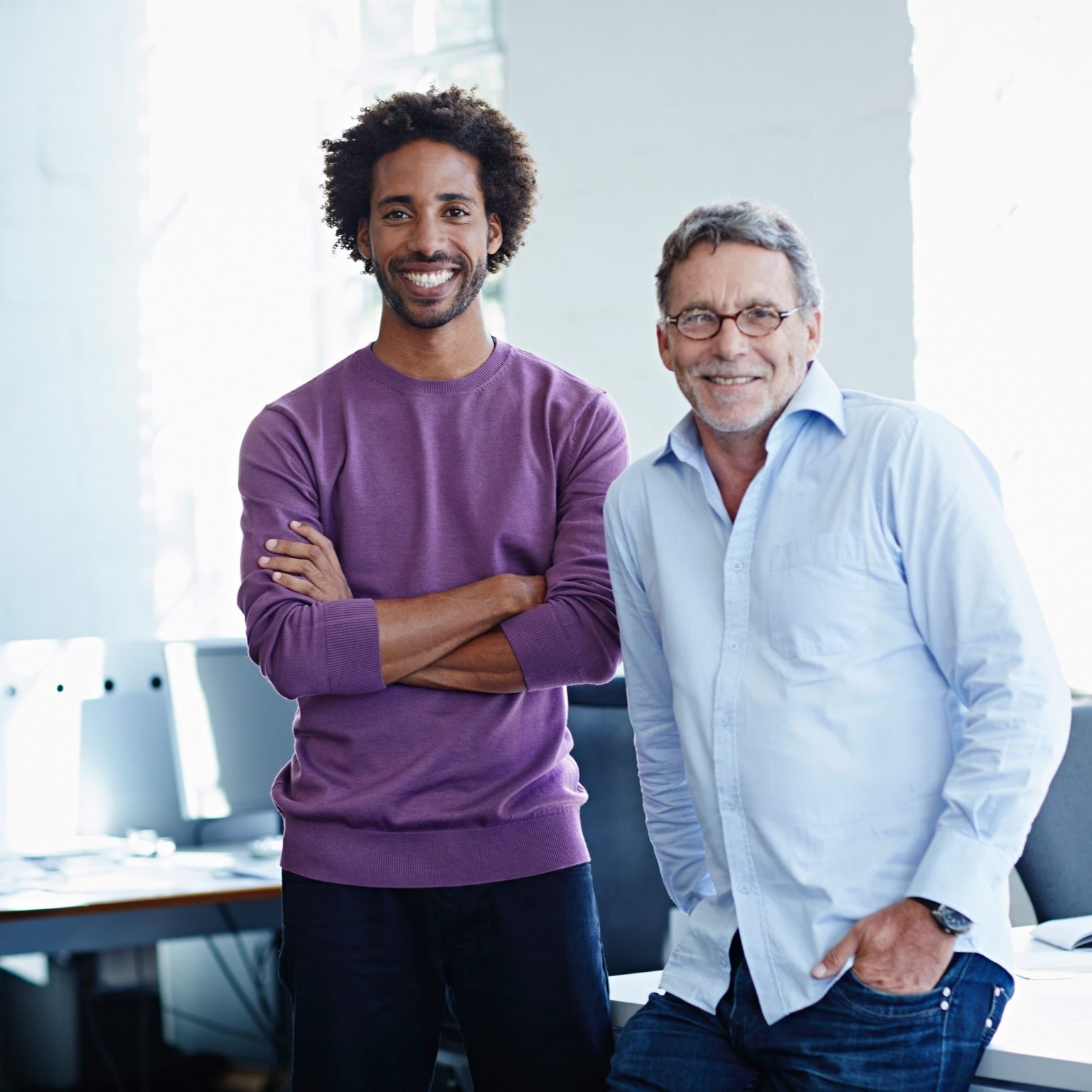Contact page image, two men standing together in office
